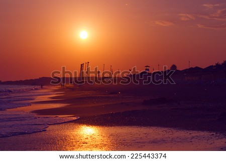 Colorful sunset above the beach - stock photo