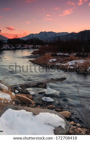 Colorful sunset above the Provo River, Utah, USA. - stock photo