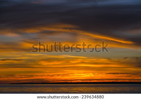 Colorful sunset above the water of Superior Lake, Canada - stock photo
