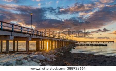 Colorful sunset at a famous public marine berth in resort city of Palanga, Lithuania, Europe