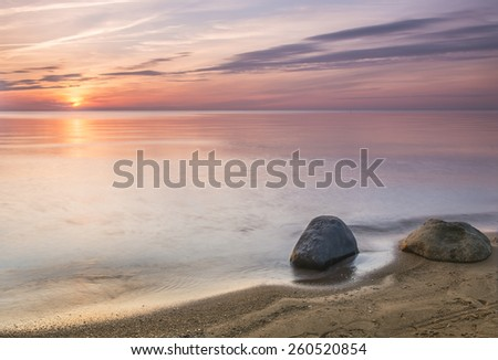 Colorful sunset at the Baltic Sea - stock photo