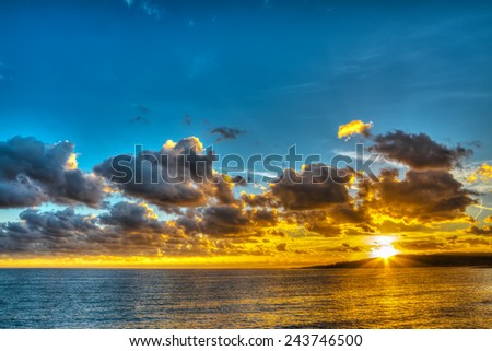 colorful sunset in Sardinia in hdr - stock photo
