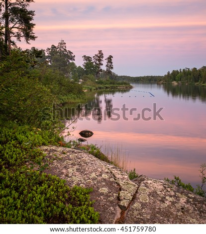 Colorful Sunset on Dogtooth Lake at Rushing River Provincial Park, Ontario, Canada - stock photo