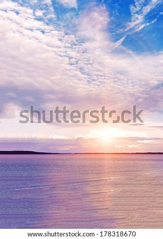 Colorful sunset on the beach. Gulf of Peter the Great. Japanese sea. Vladivostok. Russia. - stock photo