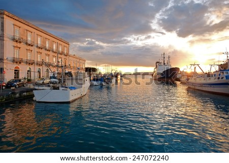 colorful sunset on the harbor of Ortigia Islet Of Siracusa, Sicily - stock photo