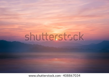 Colorful sunset on top of thailand mountain and lagoon. Vintage filter. - stock photo