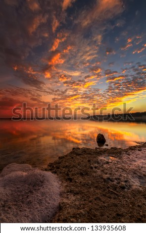 Colorful sunset over an urban Texas lake - stock photo