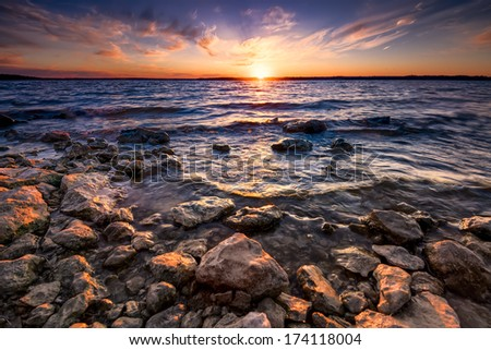 Colorful sunset over Benbrook Lake in North Texas - stock photo