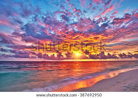 Colorful sunset over ocean on Maldives - stock photo