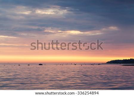 Colorful sunset over sea coast. Gulf of Finland, Baltic sea - stock photo