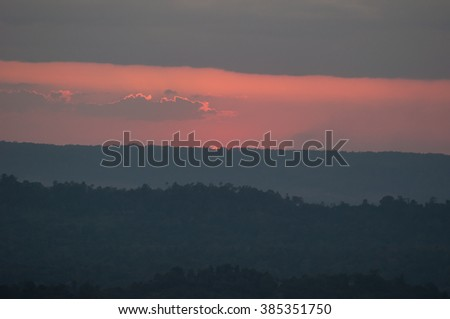 Colorful sunset over the mountain - stock photo