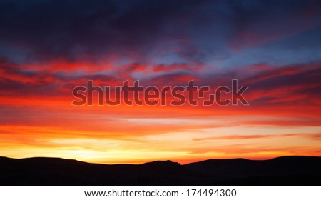 Colorful sunset over the mountain hills - stock photo