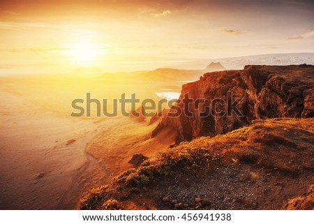 Colorful sunset over the mountains. Fantastic views of the landscape in Iceland.