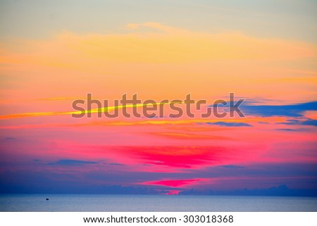 colorful sunset over the sea in Alghero, Italy