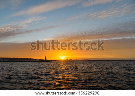 Colorful sunset sky over Tallinn cityscape, wide angle view - stock photo