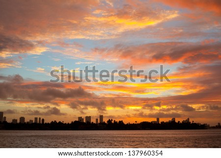 Colorful sunset with clouds over the city of Miami Florida - stock photo