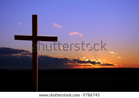 Colorful sunset with cross - stock photo