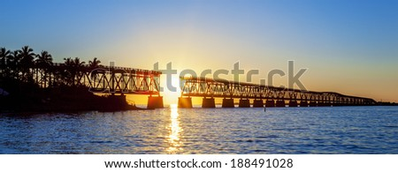 Colorful sunset with famous broken bridge, Key West, panoramic view - stock photo
