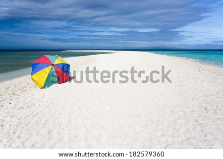 Colorful sunshade on pure tropical white beach, Camiguin island, Philippines