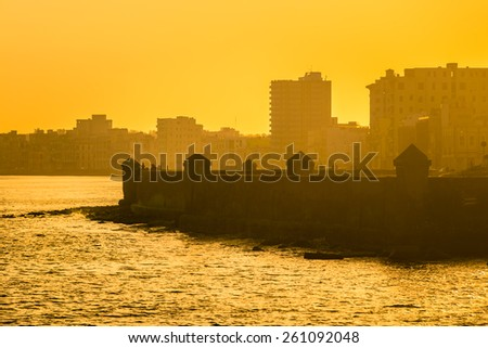 Colorful surise in Havana with a view of the malecon seawall and the city skyline - stock photo