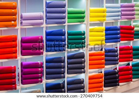 Colorful sweaters on the shop shelves - stock photo