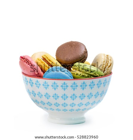 colorful sweet macarons in a bowl, isolated