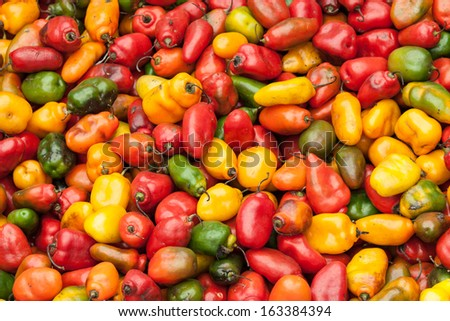 Colorful sweet peppers on a market in Peru, South America
