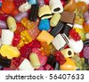 Colorful sweets and candies mixture - stock photo