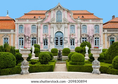 Colorful symmetrical image of the exterior of the Queluz National Palace of Portugal, located in Sintra near Lisbon - stock photo