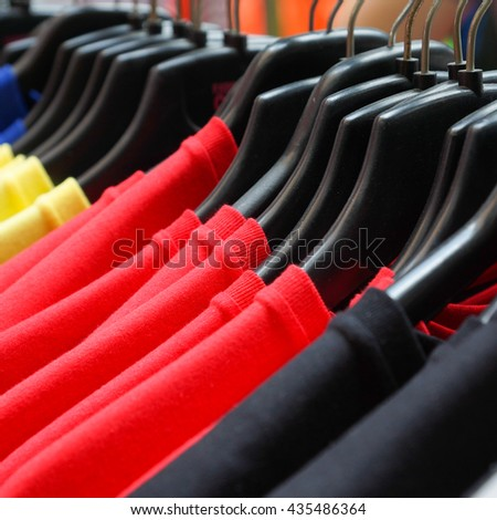 Colorful T-shirt for sale - Cloth hanger - Square shaped - stock photo