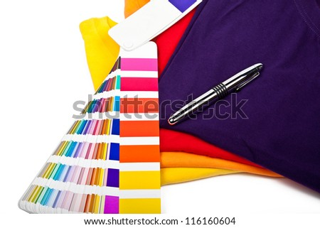 colorful t shirts, color chart and ballpoint pen - stock photo