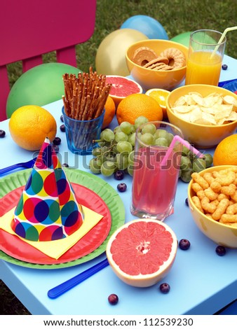Colorful table set for children,garden party - stock photo
