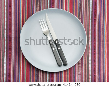 Colorful table setting with knife and fork