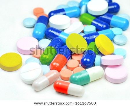 Colorful tablets, capsules in white background - stock photo