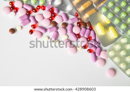 Colorful tablets on white background