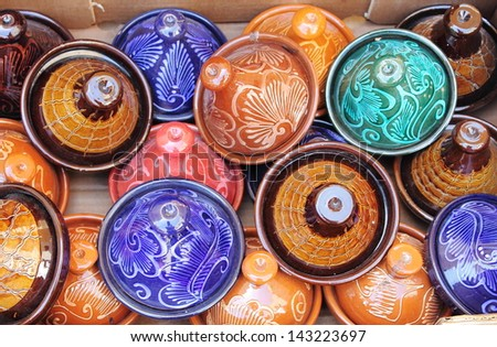 Colorful Tajines for sale in a market stall