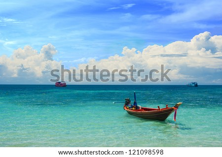 Colorful taxi boat in the tropical paradise sea - stock photo