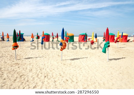 Colorful tents and umbrellas on famous Deauville beach, Normandy - stock photo