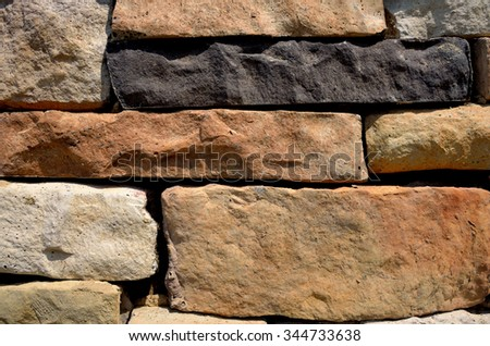 Colorful textured rock stone wall, abstract backdrop or background