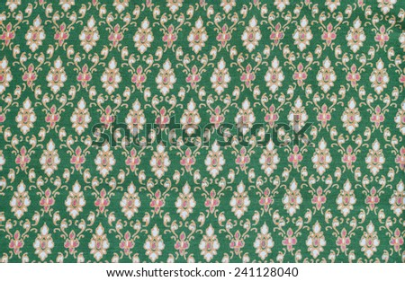 Colorful Thai fabric pattern as background.