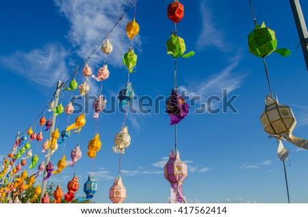 colorful thai lantern hanging on rope - stock photo