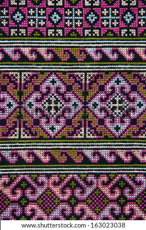 Colorful thai peruvian style rug surface close up.  - stock photo