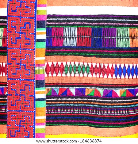 Colorful thai peruvian style rug surface close up. More of this motif & more textiles in my port tatter Old rag - stock photo