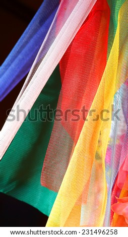 Colorful Thai plastic garland, can be found at any Buddhist Temple - stock photo