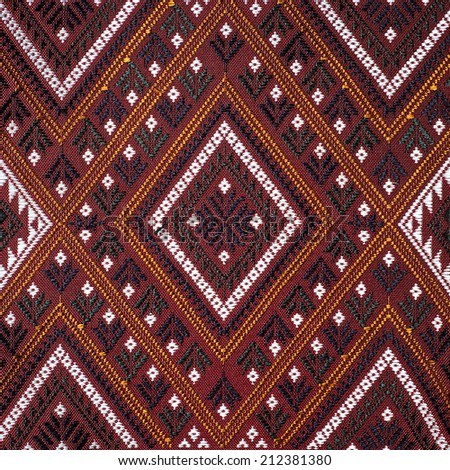 Colorful thai silk handcraft peruvian style rug surface close up More this motif & more textiles peruvian stripe beautiful background tapestry persian nomad detail pattern farabic fashionable textile. - stock photo