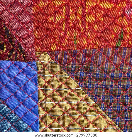 Colorful thai silk peruvian style rug surface close up. More of this motif & more textiles in my port tatter old rag blue brown pink - stock photo