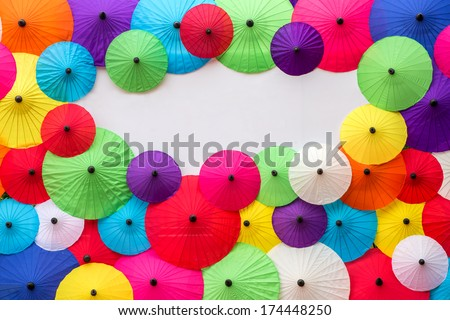 Colorful Thai traditional handmade umbrellas background with space for your text - stock photo