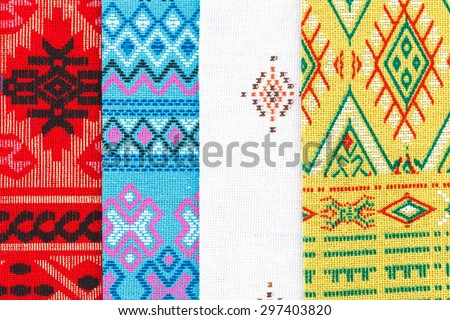 Colorful Thailand style rug surface close up vintage fabric is made of hand. Colorful thai silk pattern background.