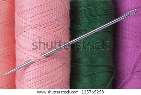 Colorful thread and needle macro