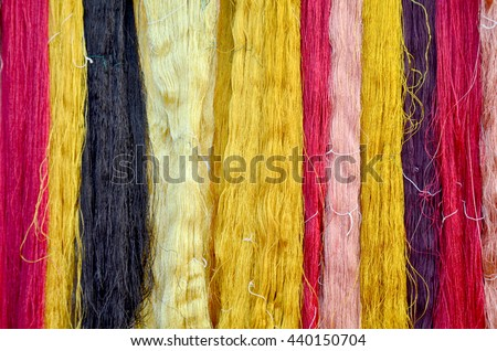 Colorful thread silks dye from natural color material for woven silk handicraft thai style at isan of Thailand - stock photo